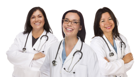 Three Hispanic and Mixed Race Female Doctors or Nurses Isolated on a White Background. Reklamní fotografie