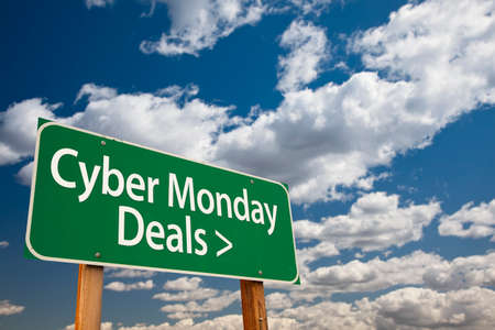 Cyber Monday Deals Green Road Sign with Dramatic Clouds and Sky. photo