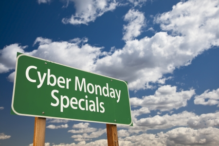 Cyber Monday Specials Green Road Sign with Dramatic Clouds and Sky. photo