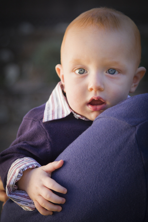 Adorable Infant Boy Portrait Outdoors with Dramatic Lighting. photo