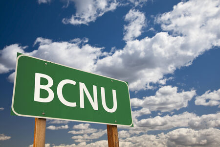 abbreviation: BCNU, Texting Abbreviation for Be Seeing You, Green Road Sign with Dramatic Sky and Clouds.