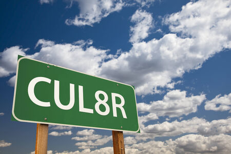 abbreviation: CUL8R, Texting Abbreviation for See You Later, Green Road Sign with Dramatic Sky and Clouds.