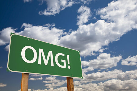 abbreviation: OMG!, Texting Abbreviation for Oh My Gosh, Green Road Sign with Dramatic Sky and Clouds.