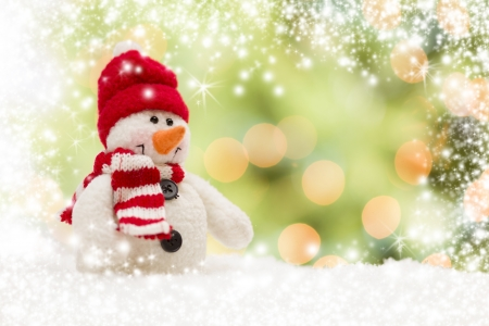 Cute Snowman Over Green and Gold Snow and Light Abstract Background. Stock Photo