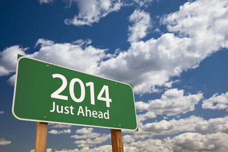 just ahead: 2014 Just Ahead Green Road Sign Over Dramatic Clouds and Sky. Stock Photo