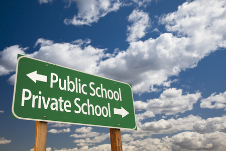 private public: Public or Private School Green Road Sign Over Dramatic Clouds and Sky.