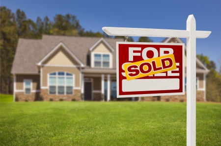 for: Sold Home For Sale Real Estate Sign in Front of Beautiful New House. Stock Photo