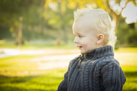 flaxen: Adorable Little Blonde Baby Boy Outdoors at the Park.