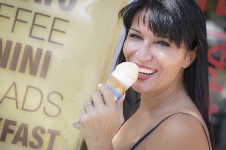 Pretty Italian Woman Enjoying Her Gelato at the Street Market. photo