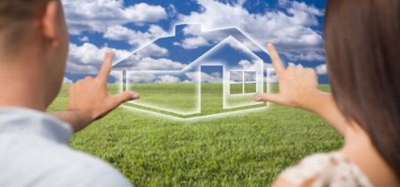 house in hand: Dreaming Couple Framing Hands Around Ghosted House Figure in Grass Field.