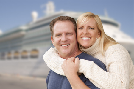 adult cruise: Young Happy Couple Hugging On The Dock In Front of a Cruise Ship. Stock Photo