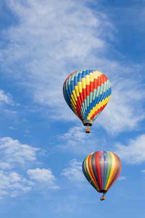 Beautiful Hot Air Balloons Against a Deep Blue Sky and Clouds. photo