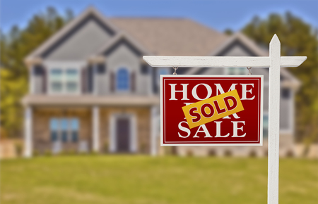 Sold Home For Sale Real Estate Sign in Front of Beautiful New House  Фото со стока