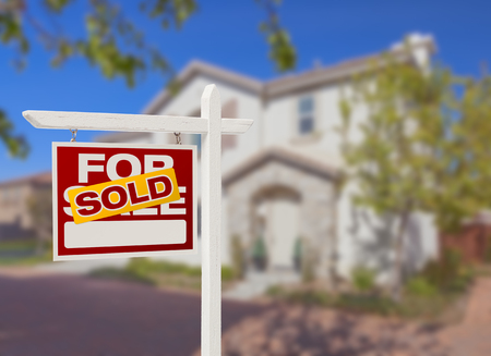 first home: Sold Home For Sale Real Estate Sign in Front of Beautiful New House  Stock Photo