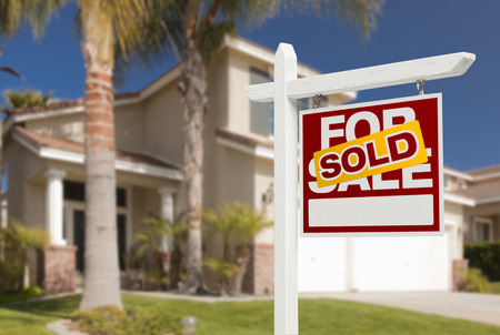 sold: Sold Home For Sale Real Estate Sign in Front of Beautiful New House. Stock Photo