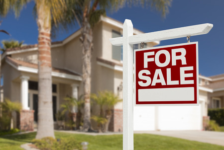 Home For Sale Real Estate Sign in Front of Beautiful New House. Imagens