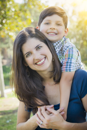 Attractive Young Mixed Race Mother and Son Hug Outdoors in the Park. Stok Fotoğraf - 28150835