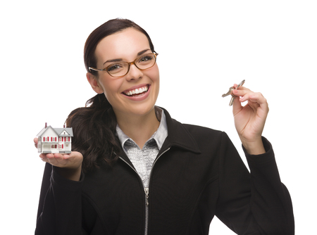first time buyer: Mixed Race Female Presenting House Keys Holding a Small House Isolated on White Background.