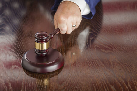 fairly: Judge Slams His Gavel and American Flag Table Reflection.