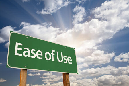 at ease: Ease of Use Green Road Sign with Dramatic Clouds and Sky. Stock Photo