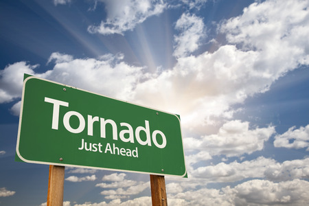 Tornado Green Road Sign with Dramatic Clouds and Sky. photo
