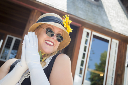 twenties: Attractive Young Woman in Twenties Outfit Near Antique House. Stock Photo