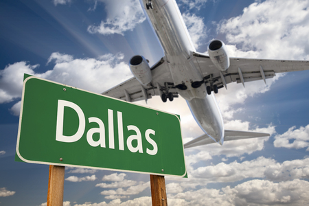 airport sign: Dallas Green Road Sign and Airplane Above with Dramatic Blue Sky and Clouds.