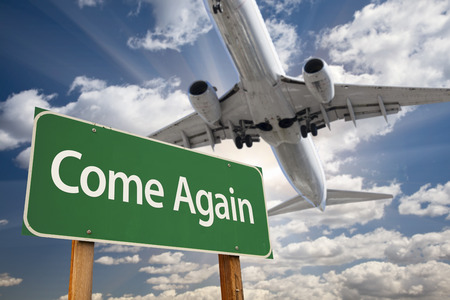 again: Come Again Green Road Sign and Airplane Above with Dramatic Blue Sky and Clouds. Stock Photo