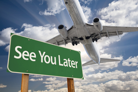 later: See You Later Green Road Sign and Airplane Above with Dramatic Blue Sky and Clouds. Stock Photo