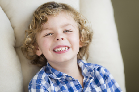 baby 4 5 years: Cute Blonde Boy Smiling for Portrait Sitting in Chair. Stock Photo