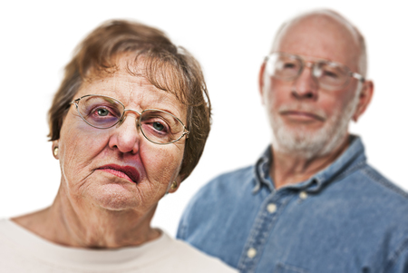 Battered and Scared Woman with Ominous Angry Man Behind. photo