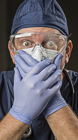 latex glove: Stunned Male Doctor or Nurse with Protective Wear and Stethoscope.