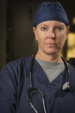 Attractive Female Doctor or Nurse Portrait Wearing Stethoscope. photo