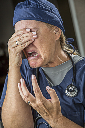 Hysterical Agonizing Crying Female Doctor or Nurse. Stock Photo