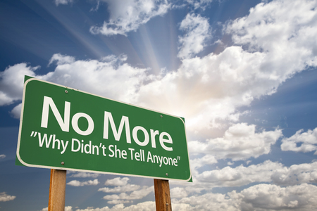 abusing: No More - Why Didnt She Tell Anyone Green Road Sign with Dramatic Clouds and Sky.