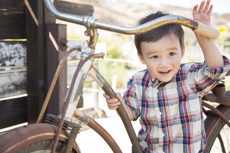Cute Mixed Race Young Boy Having Fun on the Bicycle. photo