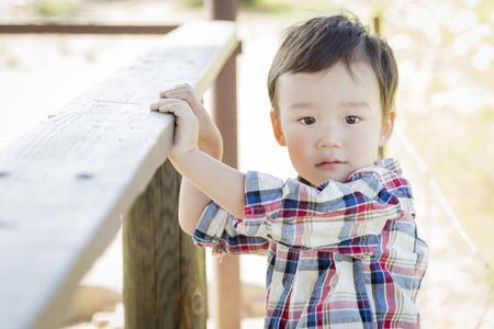 Cute Mixed Race Young Boy Having Fun Outside.