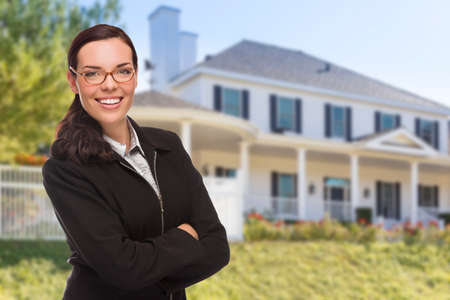 custom built: Attractive Mixed Race Woman in Front of Beautiful New Custom Built House. Stock Photo