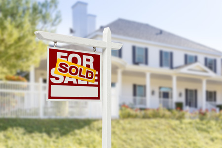 sale sign: Sold Home For Sale Real Estate Sign in Front of Beautiful New House. Stock Photo