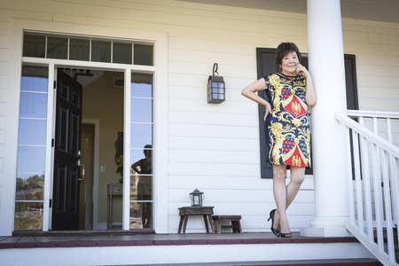 front porch: Happy Attractive Chinese Woman On Her Front Porch.