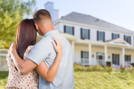 person looking: Affectionate Military Couple Looking at Nice New House.