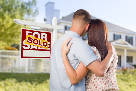 looking for love: Sold For Sale Real Estate Sign and Affectionate Military Couple Looking at Nice New House. Stock Photo