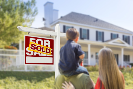look for: Curious Family Facing Sold For Sale Real Estate Sign and Beautiful New House.