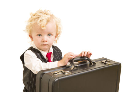 Cute Boy in Vest Suit and Tie with Briefcase On White photo