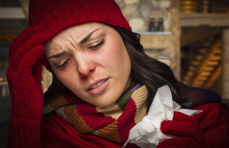 Bundled Up Sick Woman Inside Cabin With Tissue. photo