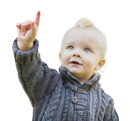 화이트 절연 따뜻한 스웨터 가리키는에서 행복 귀여운 작은 소년.