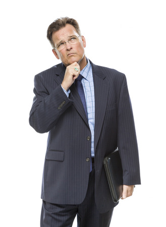 Handsome Businessman With Hand on Chin and Looking Up and Over Isolated on a White Background. Stock Photo