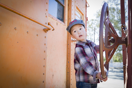 caboose: Cute Young Mixed Race Boy Having Fun Outside on Railroad Car.