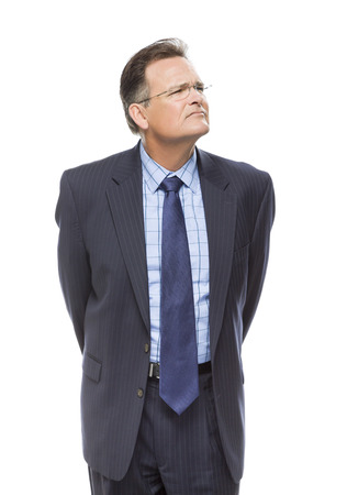 Handsome Businessman Looking Up and Over Isolated on a White Background. Stock Photo