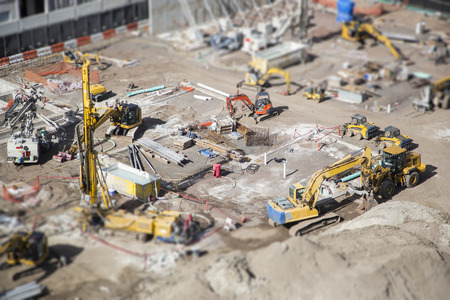 Aerial View of Busy Construction Site with Extreme Bokeh.